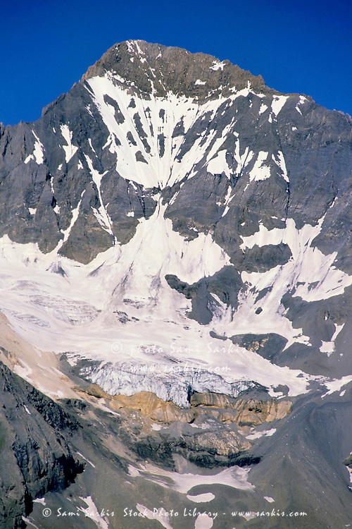 Glacier and snowy mountain summit in Vanoise National Park, French Alps, France.