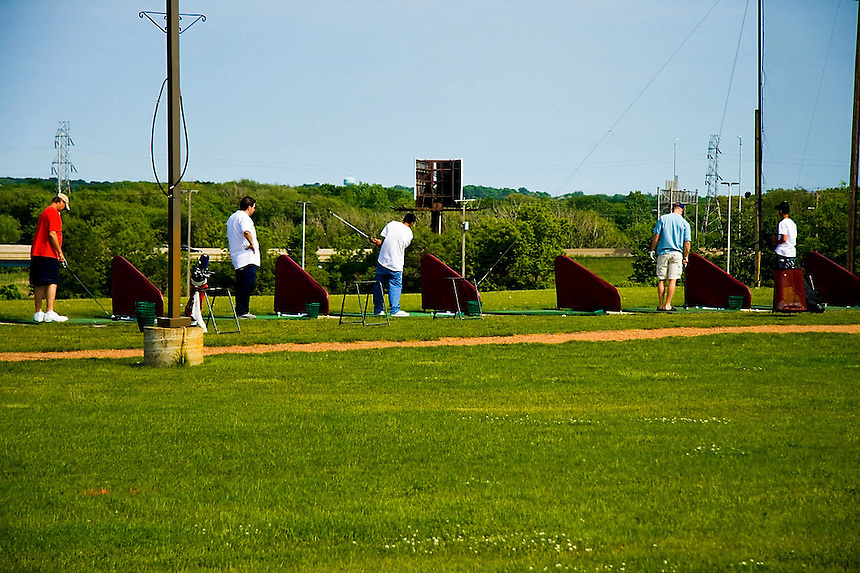 Practice time on a golfing driving range.