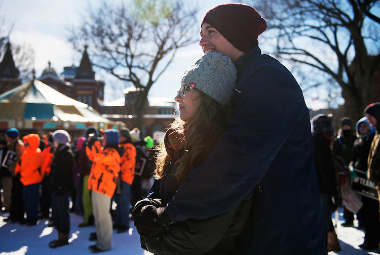 UNITED STATES - JANUARY 22: Bryan McCormack and Tara Hettrick of New Hampshire, stay warm during a rally on the Mall for the March for Life anti-abortion demonstration. (Photo By Tom Williams/CQ Roll Call)
