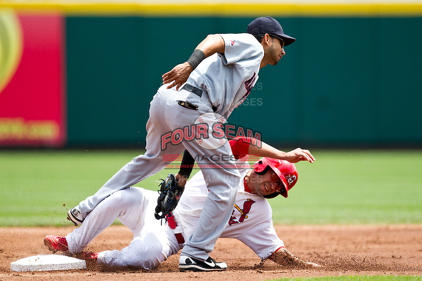 Jose Garcia (3) of the Springfield Cardinals is tagged out at second base on a pickoff attempt during a game against the Arkansas Travelers at Hammons Field on May 8, 2012 in Springfield, Missouri. (David Welker/ Four Seam Images)
