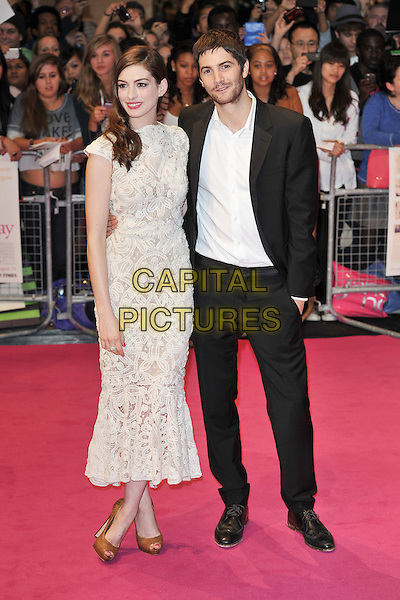 "ANNE HATHAWAY (in Alexander McQueen) & JIM STURGESS.""One Day"" UK premiere, Vue Westfield cinema, Westfield Shopping Centre, London, England..August 23rd, 2011.full length white sleeveless crochet lace dress brown hazelnut whipstitch peep toe shoes white embroidered shirt black suit .CAP/MAR.© Martin Harris/Capital Pictures."