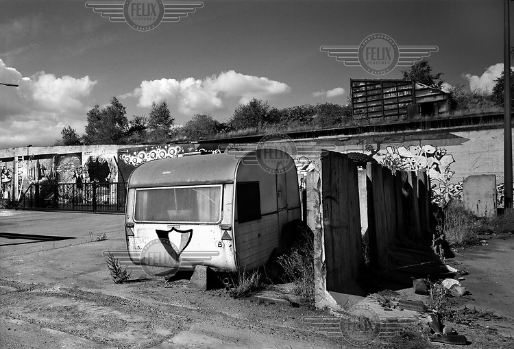 A delapidated caravan along the Sambre River. Once a thriving coal and steel city, Charleroi and the surrounding area is now suffering the typical signs of urban decline; high unemployment and the closure of centres of industrial production.