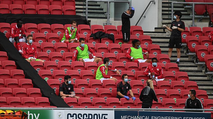 Bristol City players on the bench wearing PPE<br /> <br /> Photographer David Horton/CameraSport<br /> <br /> The EFL Sky Bet Championship - Bristol City v Sheffield Wednesday - Sunday 28th June 2020 - Ashton Gate Stadium - Bristol <br /> <br /> World Copyright © 2020 CameraSport. All rights reserved. 43 Linden Ave. Countesthorpe. Leicester. England. LE8 5PG - Tel: +44 (0) 116 277 4147 - admin@camerasport.com - www.camerasport.com
