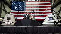 In this photo released by the National Aeronautics and Space Administration (NASA) United States Vice President Mike Pence addresses NASA employees, in front of, from left to right, the SpaceX Dragon, NASA's Orion, and Boeing's Starliner, Thursday, July 6, 2017, at the Vehicle Assembly Building at NASAís Kennedy Space Center (KSC) in Cape Canaveral, Florida. The Vice President thanked employees for advancing American leadership in space, before going on a tour of the center that highlighted the public-private partnerships at KSC, as both NASA and commercial companies prepare to launch American astronauts from the multi-user spaceport. Photo Credit: Aubrey Gemignani/NASA/CNP/AdMedia