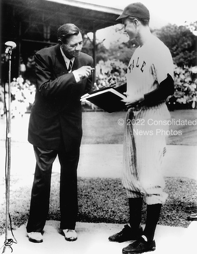 "New Haven, Connecticut - Undated file photo -- On behalf of Yale University, Yale Baseball Captain George Bush accepts ""The Babe Ruth Story"" autobiography from Babe Ruth in 1948..Credit: White House via CNP"