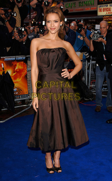 "JESSICA ALBA.At the UK Film Premiere of ""Fantastic Four"", .Vue Cinema, Leicester Square, London, .July 18th 2005..full length brown strapless dress hand on hip.Ref: MOO.www.capitalpictures.com.sales@capitalpictures.com.©Capital Pictures"
