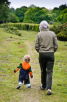 Grandma going for a walk with her grandson.