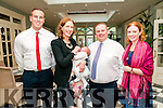 Baby Laoise Barry with her parents Breda & Pat Barry, Listowel and god parents Cathal O'Sullivan & Winnie Costello who was christened in St. Mary's Church, Listowel  by Canon Declan O'Connor on Saturday last and afterwards at the Listowel Arms Hotel.