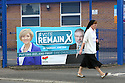 A nun walks past a 'Vote Remain' poster fixed to a school in west Belfast, County Antrim, Thursday, June 23rd, 2016, as voting got under way for the EU referendum on wether the United Kingdom should remain a member of the European Union or Leave the European Union. Photo/Paul McErlane