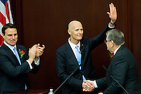 TALLAHASSEE, FLA. 3/5/13-OPENING030513CH-Gov. Rick Scott, center, is congratulated by Senate President Don Gaetz, R-Niceville, right, and Speaker of the House Will Weatherford, R-Wesley Chapel, left, after he gave the State of the State Address the opening day of the 2013 legislative session Tuesday at the Capitol in Tallahassee, Fla...COLIN HACKLEY PHOTO
