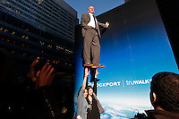 German artist Johan Lorbeer,  illustrates how lightweight the truWALK Zero shoes are through his gravity defying installation where it seems as if he and his team are suspended mid-air from a cube in New York April 5, 2012.  Photo by Kena Betancur / VIEWpress.