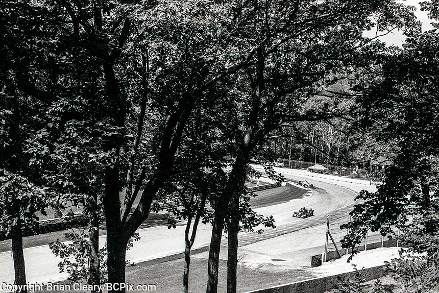 ELKHART LAKE, WI - June 23, 2017: (EDITOR'S NOTE: Photo taken on 35mm black and white film with vintage 35mm rangefinder camera) IndyCars race through the Wisconsin countryside during practice for the Kohler Grand Prix Verizon IndyCar race at Road America on June 23, 2017 in Elkhart Lake, Wisconsin. (Photo by Brian Cleary/BCPix.com)