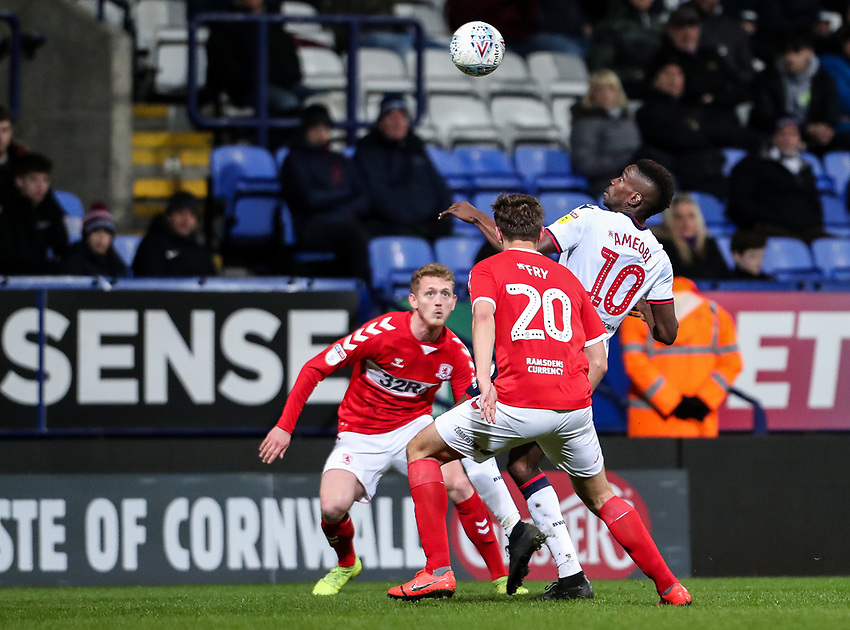 Bolton Wanderers' Sammy Ameobi competing with Middlesbrough's Dael Fry <br /> <br /> Photographer Andrew Kearns/CameraSport<br /> <br /> The EFL Sky Bet Championship - Bolton Wanderers v Middlesbrough -Tuesday 9th April 2019 - University of Bolton Stadium - Bolton<br /> <br /> World Copyright © 2019 CameraSport. All rights reserved. 43 Linden Ave. Countesthorpe. Leicester. England. LE8 5PG - Tel: +44 (0) 116 277 4147 - admin@camerasport.com - www.camerasport.com