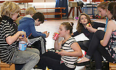 """Lunchtime fun at a drama group for 8-13s run by Yvonne Arnaud Theatre, rehearsing a production of """"Alice"""" in a school hall, Guildford, Surrey."""