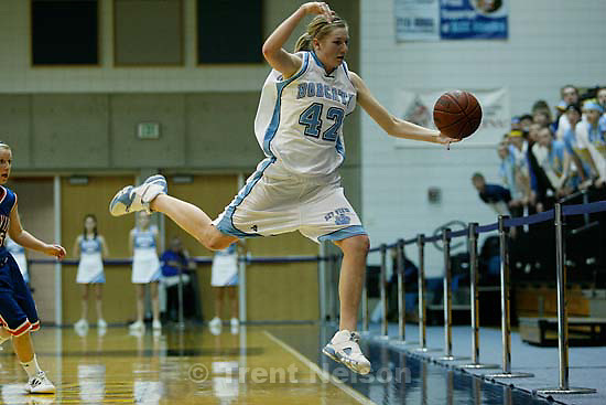 Taylorsville - Sky View's Aubry Boehme leaps to save the ball going out of bounds. Sky View vs. Timpview, 4A State Girls high school basketball state championship game at Salt Lake Community College, Saturday, February 23, 2008.