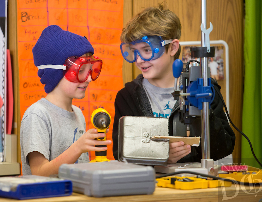 NWA Democrat-Gazette/JASON IVESTER<br /> Evan Beckcom (cq) (left) and Evan Jackson, both sixth-graders, use a Dremel tool to shape their airplane on Wednesday, Feb. 8, 2017, at Old High Middle School in Bentonville. Six schools across the region recently launched fundraising campaigns for their maker spaces, which promote education through hands-on work using various tools, 3-D printers, circuitry kits and other materials.