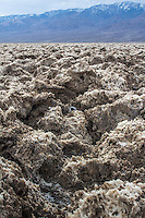 The Devil's Golf Course in Death Valley National Park in California.   It is a large salt pan from former Lake Manly and was created by many years of  weathering.
