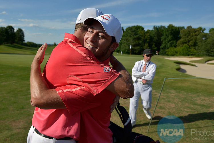 20 MAY 2015:  Teammates hug Sam Migdal of Central Missouri after he won the Division II Men's Individual Golf Championship held at the Rock Barn Golf & Spa in Conover, NC. Migdal shot a -8 to win the individual national title. Grant Halverson/NCAA Photos