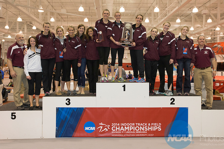 15 MAR 2014: The Women's team from the University of Wisconsin-La Crosse stand at the podium with their second place trophy during the Div III Indoor Track and Field Championships at the Bob Devaney Sports Center in Lincoln, Nebraska. Scott Bruhn/NCAA Photos