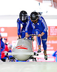 18 December 2010: Alexander Kasjanov starts up his 2-man bobsled for Russia, finishing in 10th place at the Viessmann FIBT World Cup Bobsled Championships on Mount Van Hoevenberg in Lake Placid, New York, USA. Mandatory Credit: Ed Wolfstein Photo