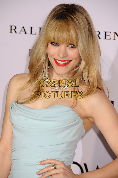 "Rachel McAdams.""The Vow"" Los Angeles Premiere held at Grauman's Chinese Theatre, Hollywood, California, USA..February 6th, 2012.half length dress hand on hip red lipstick necklace silver gold chains fringe bangs hair blue strapless  smiling .CAP/ADM/BP.©Byron Purvis/AdMedia/Capital Pictures."