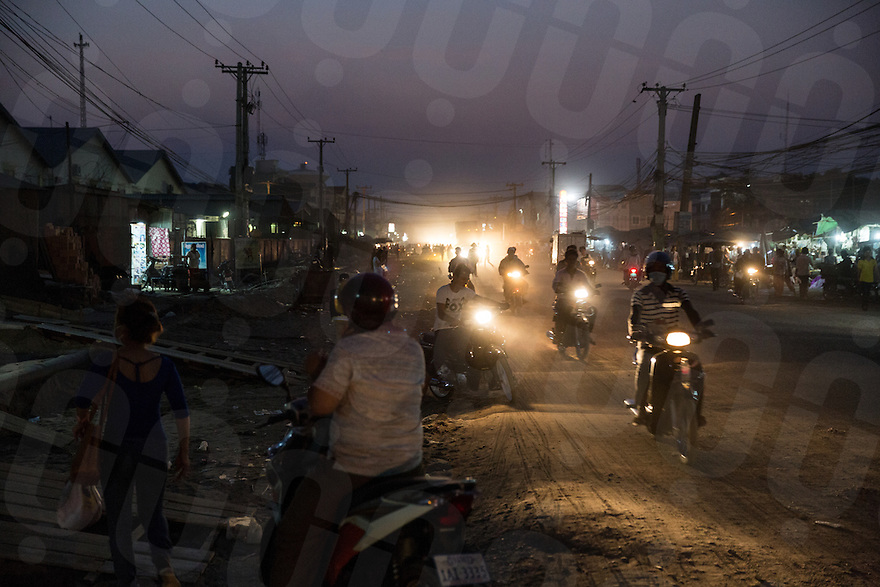 Feb 01, 2014 - Phnom Penh, Cambodia. Factory workers on a Veng Sreng road where many factories are located. © Nicolas Axelrod / Ruom