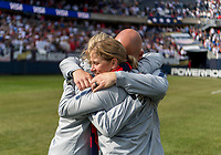 CHICAGO, IL - OCTOBER 6: Jill Ellis of the United States hugs her coaches during a game between Korea Republic and USWNT at Soldier Field on October 6, 2019 in Chicago, Illinois.