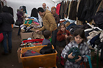 Refugees at the Landesamt für Gesundheit und Soziales (LaGeSo), the Berlin administration facility for health and social welfare, choosing clothes from public donations. The administration buildings and surrounding land became the main registration centre and first point of contact with the authorities for refugees arriving in Berlin from July 2015 onwards. Around 60,000 refugees arrived in the city in the first 10 months of 2015, out of an overall total of around 850,000 in the whole of Germany.