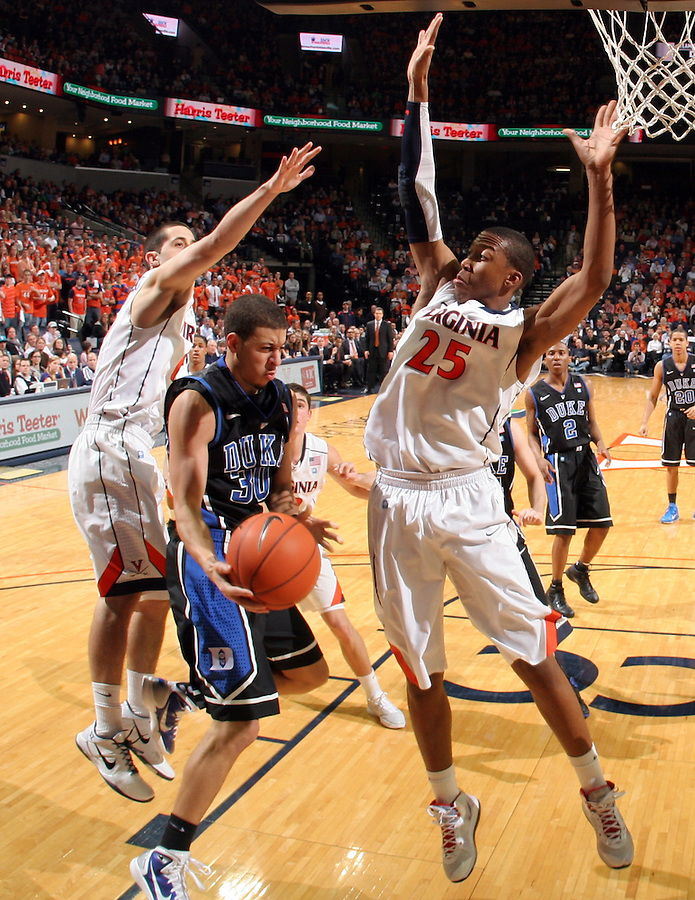 Feb. 16, 2011; Charlottesville, VA, USA; Duke Blue Devils guard Seth Curry (30) shoots between Virginia Cavaliers guard Sammy Zeglinski (13) and Virginia Cavaliers forward Akil Mitchell (25) during the second half of the game at the John Paul Jones Arena. The Duke Blue Devils won 56-41.  Credit Image: © Andrew Shurtleff
