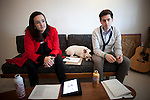 BROOKLYN -- APRIL 22, 2011: Pinky (C) sits between Tina Roth Eisenberg (L) and Skylar Challand (R) during a meeting at Studiomates on April 22, 2011 in Dumbo, Brooklyn.   (PHOTOGRAPH BY MICHAEL NAGLE)