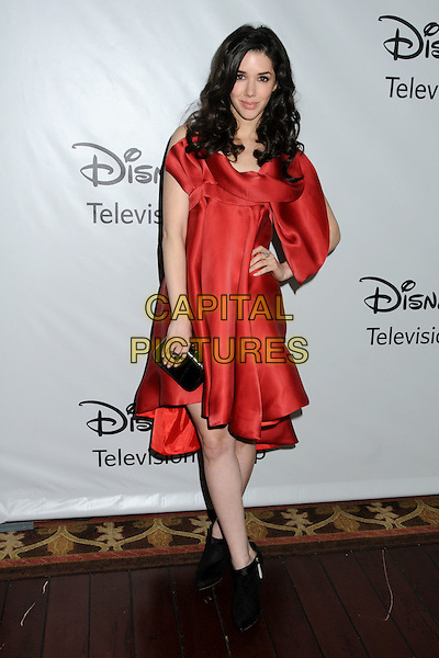 Erica Dasher.Disney ABC 2012 TCA Winter Press Tour held at the Langham Huntington Hotel, Pasadena, California, USA..January 10th, 2012.full length black shoes clutch bag red silk satin dress hand on hip.CAP/ADM/BP.©Byron Purvis/AdMedia/Capital Pictures.