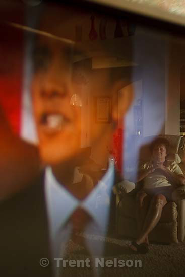 North Salt Lake - Reflected in her television screen, Margaret Johnson watches President Barack Obama addressing Congress about health reform, Wednesday, September 9 2009.