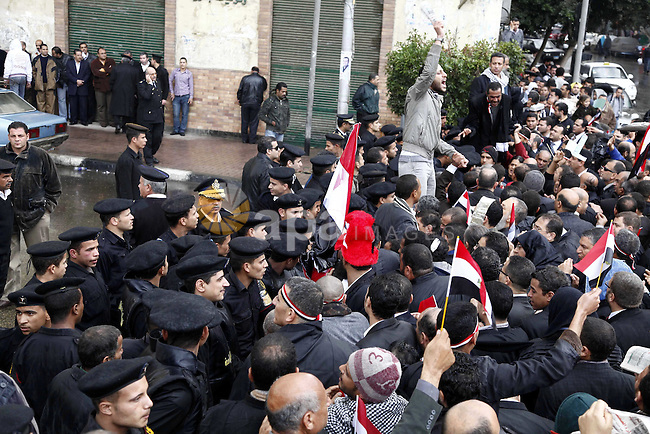 Egyptian riot police clashes with Egyptian protesters demonstrate at the gate of the presidential palace in Cairo, Egypt, Thursday, Feb. 10, 2011. Egypt's foreign minister warns of a military coup if protesters continue mass demonstrations and don't follow a government-run framework for enacting gradual reform. The comments by Foreign Minister Ahmed Aboul Gheit were the second veiled threat this week from the regime of a direct military takeover if protests persist. Photo by Karam Nasser