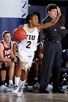 9 January 2010:  FIU's Cherisse Buddy (2) handles the ball in the first half as the Troy Trojans defeated the FIU Golden Panthers, 61-59, at the U.S. Century Bank Arena in Miami, Florida.