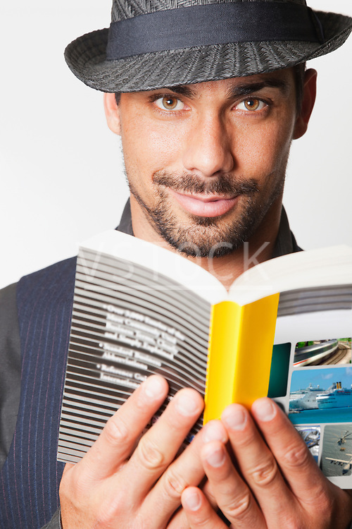 USA, California, Fairfax, Man wearing hat reading book