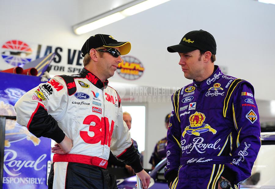 Mar. 4, 2011; Las Vegas, NV, USA; NASCAR Sprint Cup Series driver Greg Biffle (left) talks with teammate Matt Kenseth during practice for the Kobalt Tools 400 at Las Vegas Motor Speedway. Mandatory Credit: Mark J. Rebilas-