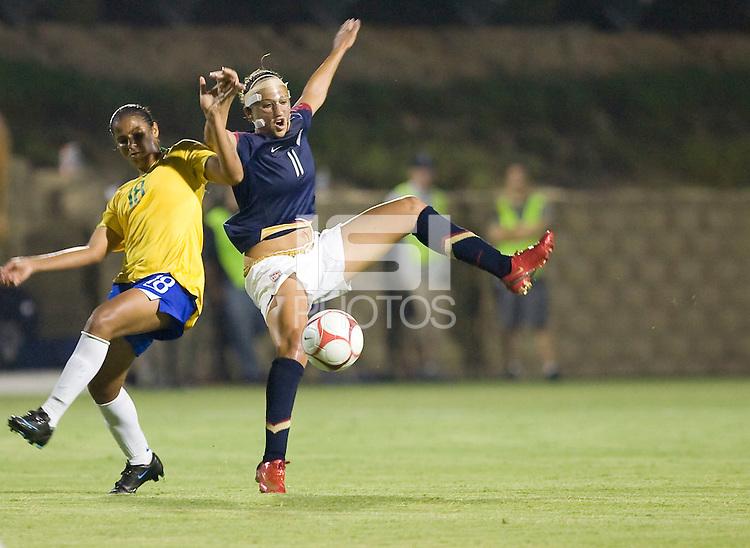 Carli Lloyd battles for the ball against Brazil's Fabiana. USA defeated Brazil 1-0, Torero Stadium, San Diego, California, July 16, 2008.