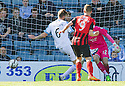 Dundee's Iain Davidson defects the ball into his own net for St Johnstone's second.