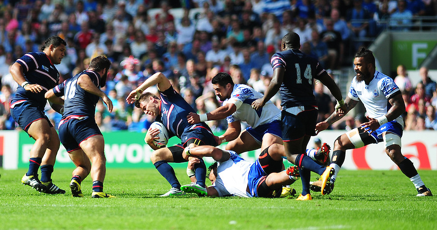 USA's Chris Wyles is tackled by Samoa's Census Johnston<br /> <br /> Photographer Kevin Barnes/CameraSport<br /> <br /> Rugby Union - 2015 Rugby World Cup - Samoa v USA - Sunday 20th September 2015 - Brighton Community Stadium - Falmer - Brighton<br /> <br /> &copy; CameraSport - 43 Linden Ave. Countesthorpe. Leicester. England. LE8 5PG - Tel: +44 (0) 116 277 4147 - admin@camerasport.com - www.camerasport.com