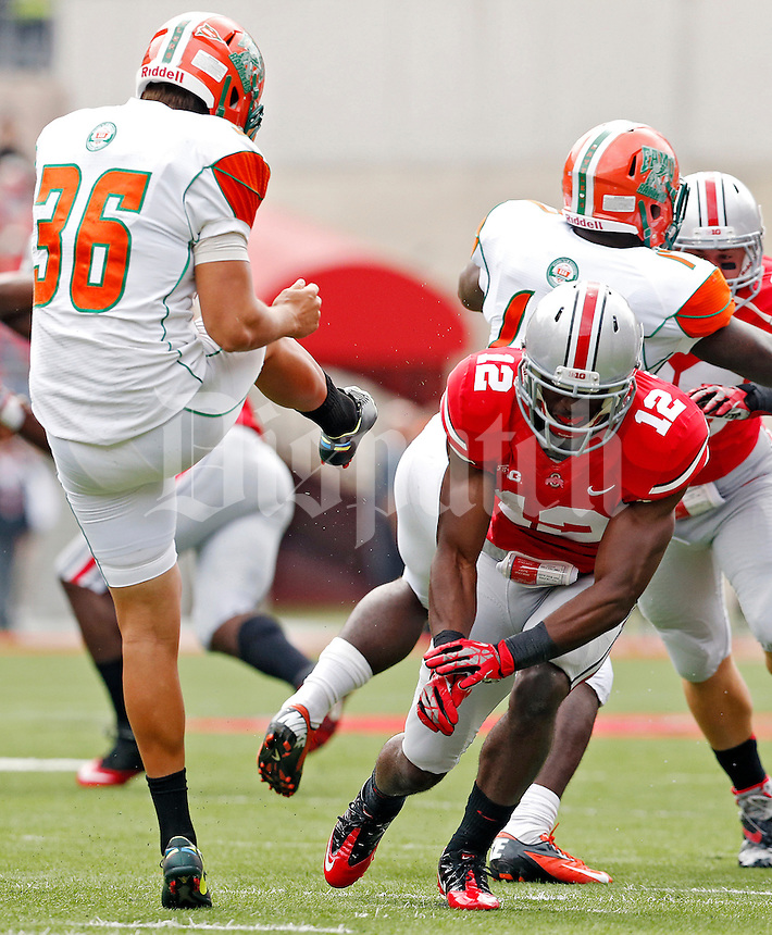 Ohio State Buckeyes cornerback Doran Grant (12) blocks the punt of Florida A&M Rattlers kicker Colby Blanton (36) in the 1st quarter during their college football game at Ohio Stadium on September 21, 2013.  (Dispatch photo by Kyle Robertson)