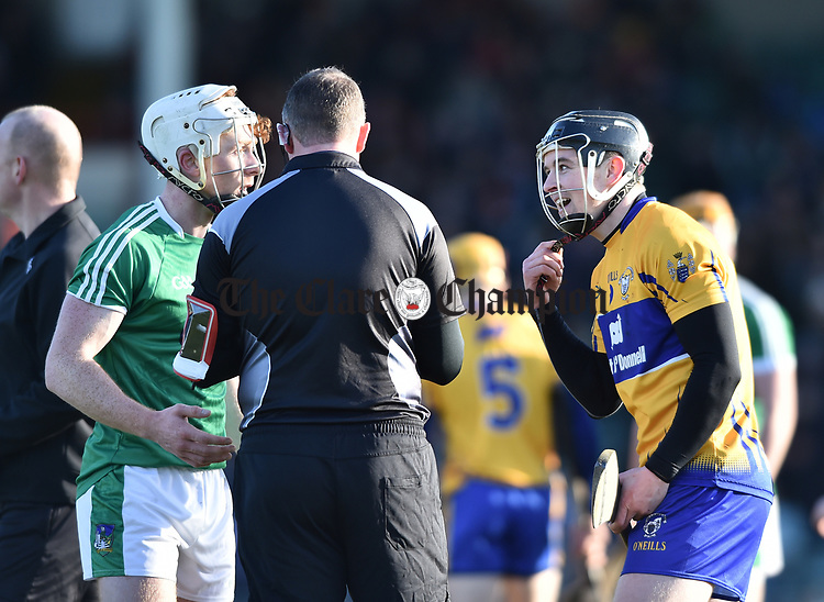 Cian Lynch of  Limerick and Tony Kelly of  Clare react to referee Alan Kelly's comments during their NHL quarter final at the Gaelic Grounds. Photograph by John Kelly.