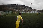 A visiting player taking a throw-in during the first-half as Cambrian and Clydach Vale take on Cwmbran Celtic at King George's New Field in a Welsh League Division One match, the top division of the Welsh Football League and the second level of the Welsh football league system. The club, formed in 1965 reached the final of the 2018-19 League Cup final and can count on ex-England manager Terry Venables as a former club chairman. Cambrian and Clydach Vale won this match 2-0, watch by a crowd of around 100 spectators.
