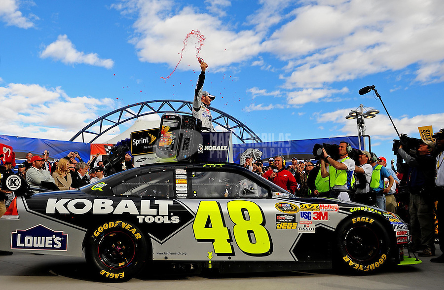 Feb. 28, 2010; Las Vegas, NV, USA; NASCAR Sprint Cup Series driver Jimmie Johnson celebrates after winning the Shelby American at Las Vegas Motor Speedway. Mandatory Credit: Mark J. Rebilas-