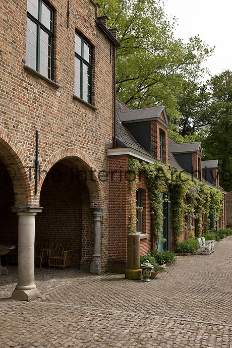 A side view of the loggia from the cobbled courtyard