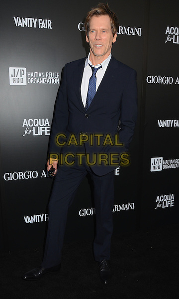 Kevin Bacon.Attending the Giorgio Armani party to celebrate Paris Photo Los Angeles at Paramount Studios, Hollywood, California, USA, .25th April 2013..full length  navy blue tie suit hand in pocket white shirt .CAP/ADM/BT.©Birdie Thompson/AdMedia/Capital Pictures