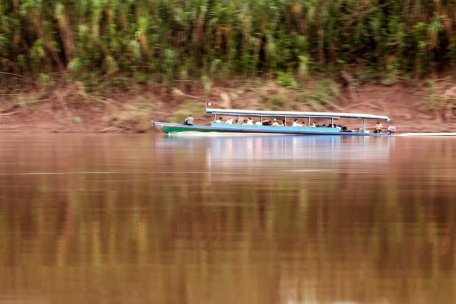 Tour boat running up Tambopata River, Peru