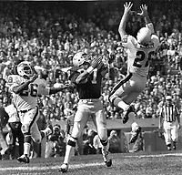Philadelphia Eagle #28 Bill Bradley intercept Oakland Raider pass intended for Ray Chester. #26 Al Nelson.<br />