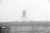 An elevated N train departs the Queensboro Plaza station in New York during Winter Storm Jonas on Saturday, January 23, 2016. Due to blizzard conditions approaching the MTA announced they will be suspending all above ground subway service as of 4:00 PM. (© Richard B. Levine)