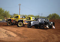 Apr 15, 2011; Surprise, AZ USA; LOORRS driver Aaron Daugherty (24) Jerry Daugherty (23) Josh Merrell (22)during round 3 and 4 at Speedworld Off Road Park. Mandatory Credit: Mark J. Rebilas-.
