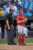 Louisville Bats catcher Chris Berset (10) and home plate umpire Chad Whitson during a game against the Syracuse Chiefs on June 6, 2016 at NBT Bank Stadium in Syracuse, New York.  Syracuse defeated Louisville 3-1.  (Mike Janes/Four Seam Images)